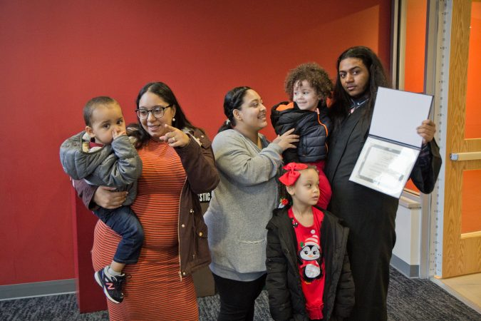 Joshua Martinez with his niece and nephews, along with his sisters Arianna, and Melinda (left). (Kimberly Paynter/Keystone Crossroads)