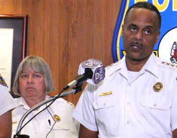 Interim Philadelphia Police Commissioner Christine Coulter stands behind former Commissioner Richard Ross during a press conference addressing racist Facebook posts on July 18, 2019. (Emma Lee/WHYY)