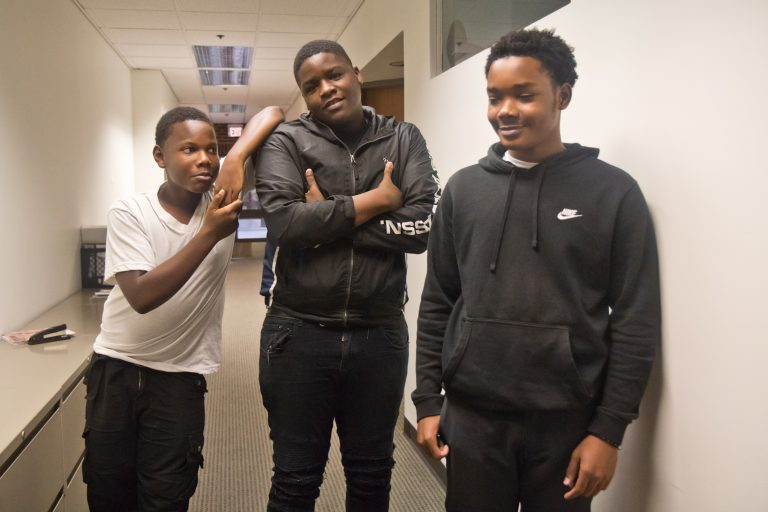 Nasir Holloman (left), Kyree Keels (center) and Kadir Douglass (right) opened a phone repair business at their school. (Kimberly Paynter/WHYY)