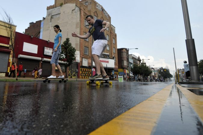People walk, stroll and roll on North Broad Street during Philly Free Streets. (Bastiaan Slabbers for WHYY)