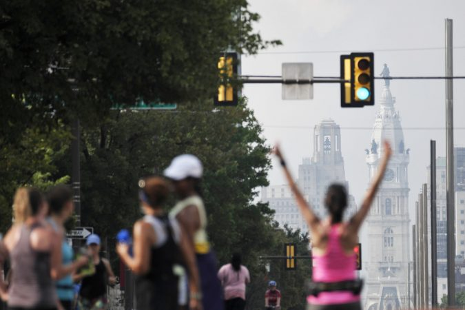 Runners take over North Broad Street during Philly Free Streets on Saturday. (Bastiaan Slabbers for WHYY)