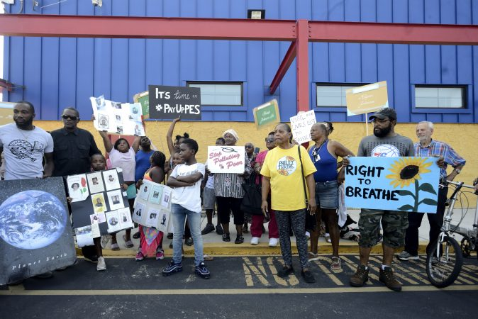 Fence-line neighbors and activists with Philly Thrive protest outside, ahead of the first public meeting of the Philadelphia Energy Solutions refinery advisory group held at Preparatory Charter School, on Tuesday. (Bastiaan Slabbers for WHYY)