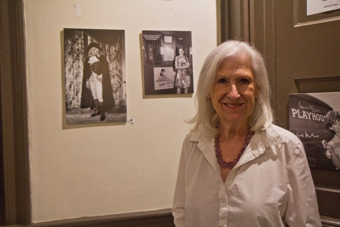 Dee Dee Bowman is the Collections Chair of the Parry Mansion Museum in New Hope. She stands in front of a photo of a young Liza Minelli on stage at the Bucks County Playhouse. (Kimberly Paynter/WHYY)