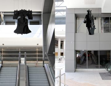 A hanging sculpture of the Liberty Bell by perceptual artist Michael Murphy becomes William Penn when viewed from a different angle. (Emma Lee/WHYY)