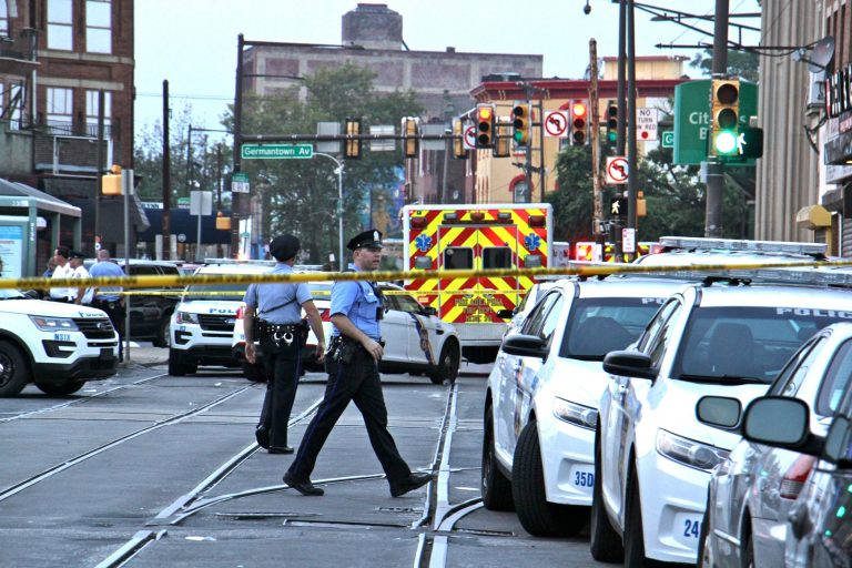 Police cordon off a large area aroung Broad and Erie streets after a gunman opened fire and held police at bay for seven hours. (Emma Lee/WHYY)