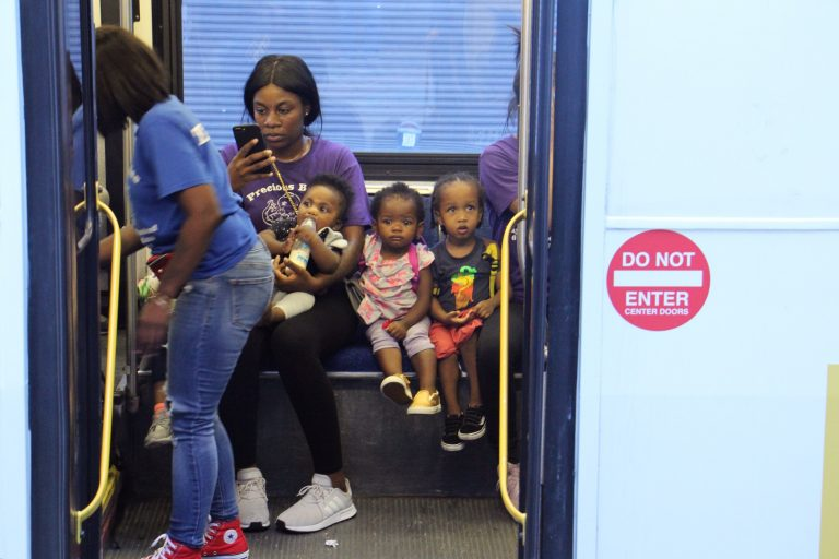 Children from the Precious Babies daycare are evacuated on SEPTA buses from the scene of a mass shooting and standoff with police. (Emma Lee/WHYY)