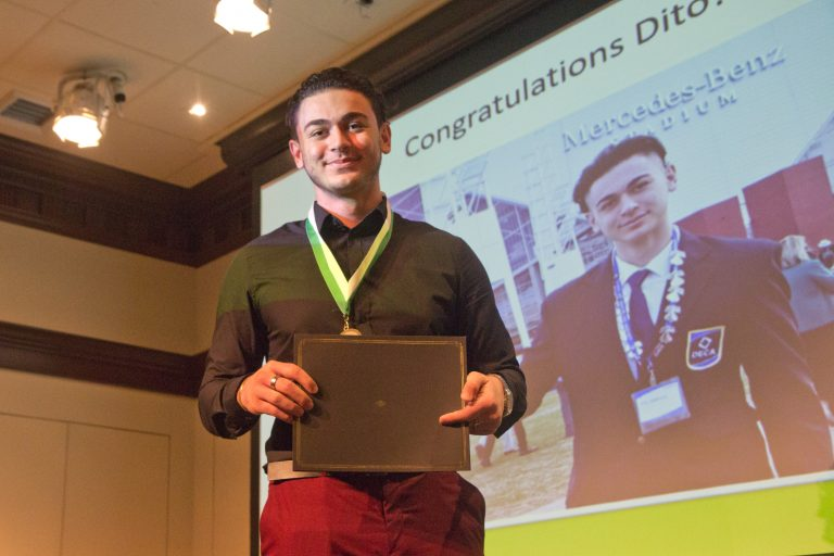 Dito Sakhokia, 18, from George Washington High School in Philadelphia receives the TD Bank Young Heroes Award at the National Liberty Museum. A recent immigrant and student of English, Sakhokia won multiple awards for public speaking. (Kimberly Paynter/WHYY)