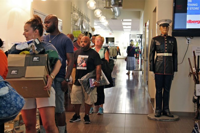 Shoppers line up at check out at I. Goldberg, which will close on Friday after 100 years in Philadelphia. (Emma Lee/WHYY)