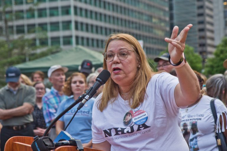 Alida Garcia's son lost his life in 2015 when a gunman fired into his car with a semi-automatic weapon. She demanded leadership ban assault weapons. (Kimberly Paynter/WHYY)