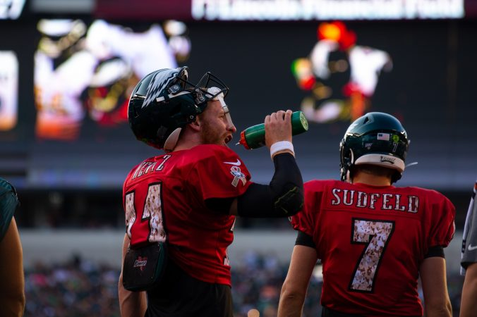Philadelphia Eagles quarterback Carson Wentz takes a drink during open practice held at Lincoln Financial Field on Sunday, August 4, 2019. (Kriston Jae Bethel for WHYY)