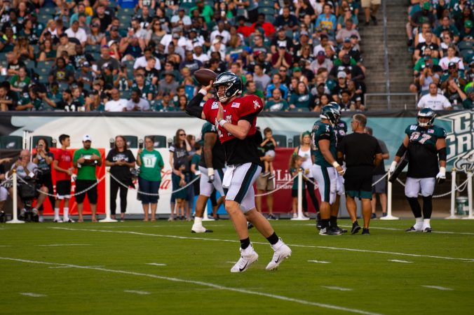 Philadelphia Eagles quarterback Carson Wentz throws a pass during drills at  open practice held at Lincoln Financial Field on Sunday, August 4, 2019. (Kriston Jae Bethel for WHYY)