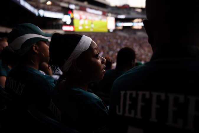 Serenity Faulkner watches the Philadephia Eagles practice at Lincoln Financial Field on Sunday, August 4, 2019. (Kriston Jae Bethel for WHYY)