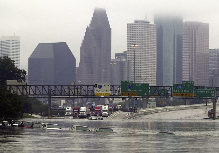 Overflow from White Oak Bayou spilled onto Interstate 45 near Quitman Street after remnants of Tropical Storm Allison inundated Houston, Texas on June 9, 2001. (AP Photo/Houston Chronicle, SMILEY N. POOL)