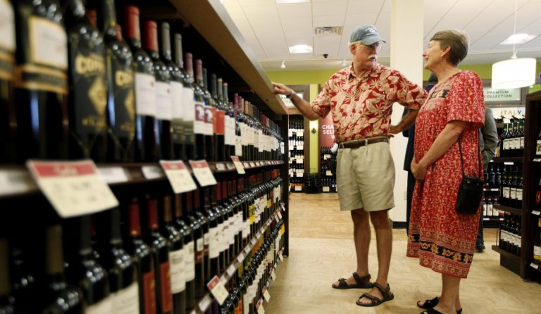 In this Thursday, July 22, 2010 file photo, Hugh and Karen Hoffman of Wycombe, Pa. shop at a state wine and liquor store in New Hope, Pa. (Matt Rourke/AP Photo)