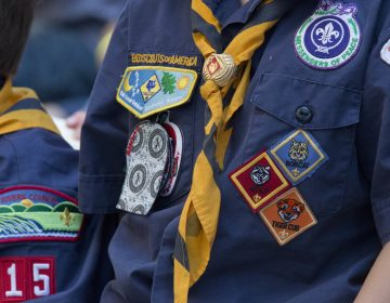 In this June 25, 2016, file photo, Cub Scouts watch a race during the Second Annual World Championship Pinewood Derby in New York's Times Square. (AP Photo/Mary Altaffer, File)