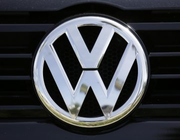 This Sept. 21, 2015, file photo, shows the Volkswagen logo on a car for sale at New Century Volkswagen dealership in Glendale, Calif. (Damian Dovarganes/AP Photo)