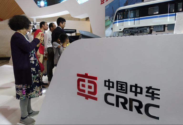 People visit the stand of CRRC (China Railway Rolling Stock Corp) during an expo in Shanghai, China, 14 June 2018. (Imaginechina via AP Images)