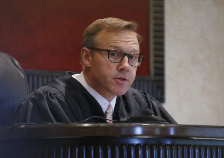In this Monday, July 8, 2019 file photo, Judge Thad Balkman speaks during Oklahoma's case blaming consumer products giant Johnson & Johnson and its subsidiaries for the state's opioid drug crisis, in Norman, Okla. (Sue Ogrocki/AP Photo, File)