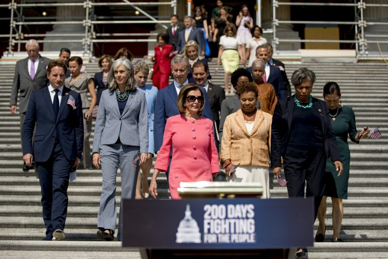 House Speaker Nancy Pelosi of Calif. and House Democrats arrive for a news conference on the first 200 days of the 116th Congress at the House East Front steps of the Capitol building, in Washington, Thursday, July 25, 2019. (Andrew Harnik/AP Photo)