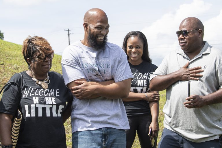 John Miller, (center), smiles with his family, Velma Miller, (left), mother, Kalita Miller, sister, and brother Lamont Washington, outside the SCI Mahanoy State Correctional Institution in Frackville, Pa. Wednesday, July 31, 2019.  Miller spent more than two decades behind bars for a murder he didn't commit, is a free man. (Jose F. Moreno/The Philadelphia Inquirer via AP)
