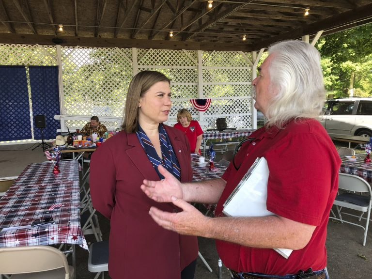Rep. Elissa Slotkin, D-Mich., talks with a constituent after a veterans event on Friday, Aug. 2, 2019, at the Ingham County Fair in Mason, Mich. Slotkin, who flipped the 8th Congressional District by defeating a Republican incumbent in 2018, has not backed an impeachment inquiry of President Donald Trump. (David Eggert/AP Photo)
