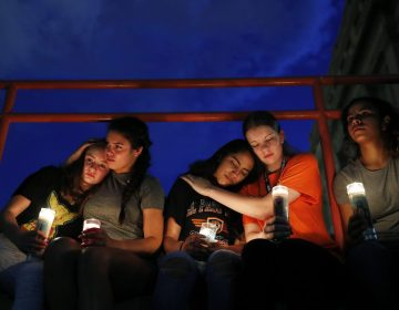 From left, Melody Stout, Hannah Payan, Aaliyah Alba, Sherie Gramlich and Laura Barrios comfort each other during a vigil for victims of the shooting Saturday, Aug. 3, 2019, in El Paso, Texas. A young gunman opened fire in an El Paso, Texas, shopping area during the busy back-to-school season, leaving multiple people dead and more than two dozen injured. (John Locher/AP Photo)