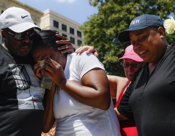 Mourners gather at a vigil following a nearby mass shooting, Sunday, Aug. 4, 2019, in Dayton, Ohio. Multiple people in Ohio have been killed in the second mass shooting in the U.S. in less than 24 hours, and the suspected shooter is also deceased, police said. (John Minchillo/AP Photo)
