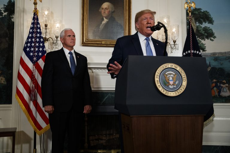 Vice President Mike Pence listens as President Donald Trump speaks about the mass shootings in El Paso, Texas and Dayton, Ohio, in the Diplomatic Reception Room of the White House, Monday, Aug. 5, 2019, in Washington. (Evan Vucci/AP Photo)