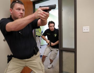 In this July 21, 2019 photo, Trainees Chris Graves, left, and Bryan Hetherington, right, participate in a security training session at Fellowship of the Parks campus in Haslet, Texas. (Tony Gutierrez/AP Photo)