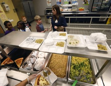 A teacher lines up the students for school-prepared lunches at Madison Crossing Elementary School in Canton, Miss., Friday, Aug. 9, 2019. Scott Clements, director of child nutrition at the Mississippi education department, said they've ordered two truckloads of trade mitigation pulled pork and four loads of kidney beans for use in their cafeterias. The products are coming from the U.S. Department of Agriculture, which is giving away the foods it's buying to help farmers hurt by trade negotiations. (Rogelio V. Solis/AP Photo)
