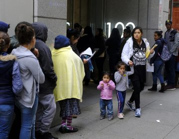 In this Jan. 31, 2019, file photo, hundreds of people overflow onto the sidewalk in a line snaking around the block outside a U.S. immigration office with numerous courtrooms in San Francisco.  (Eric Risberg/AP Photo, File)