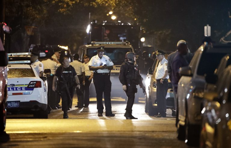 Police remain on the scene after a gunman was apprehended following a standoff Thursday, Aug. 15, 2019, in Philadelphia. A gunman who opened fire on police Wednesday as they were serving a drug warrant in Philadelphia, wounding several officers and triggering a standoff that extended into the night, is in police custody, authorities said. (AP Photo/Matt Rourke)