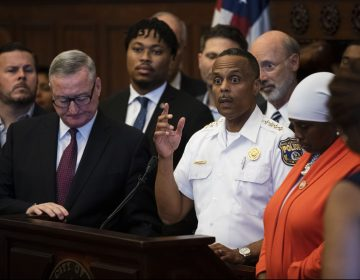 Philadelphia Police Commissioner Richard Ross, center right, speaks during a news conference at City Hall in Philadelphia, Thursday, Aug. 15, 2019. A gunman, identified as Maurice Hill, wounded six police officers before surrendering early Thursday, after a 7 ½-hour standoff.(AP Photo/Matt Rourke)