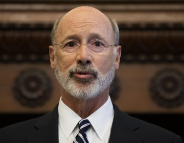 Gov. Tom Wolf speaks during a news conference at City Hall in Philadelphia, Thursday, Aug. 15, 2019. A gunman, identified as Maurice Hill, wounded six police officers before surrendering early Thursday, after a 7 ½-hour standoff. (AP Photo/Matt Rourke)