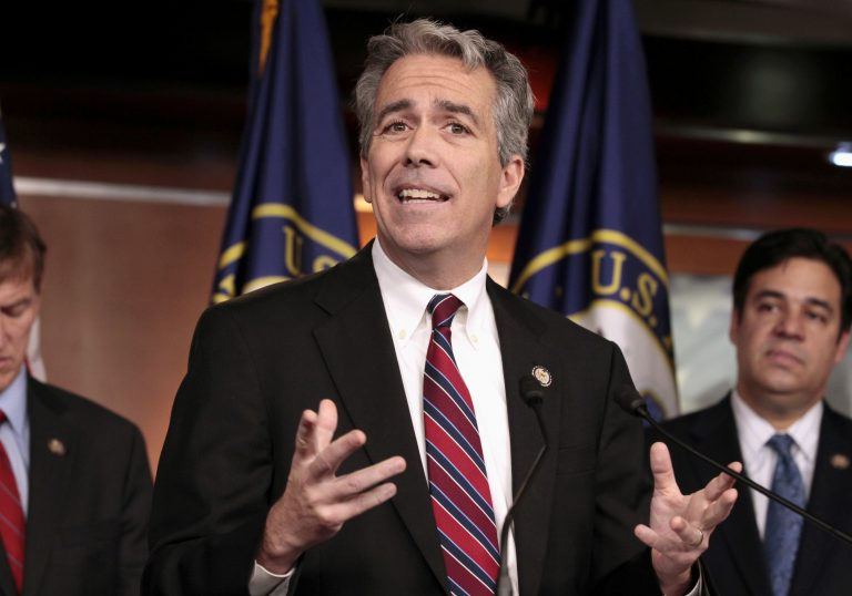 FILE - In this Nov. 15, 2011, file photo former U.S. Rep. Joe Walsh, R-Ill., gestures during a news conference on Capitol Hill in Washington. Walsh, a former Illinois congressman, says he'll challenge President Donald Trump for the Republican nomination in 2020. The tea party favorite argues that Trump is unfit for the White House. (AP Photo/Carolyn Kaster, File)