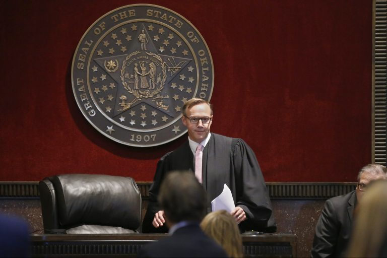 Judge Thad Balkman arrives to give his decision in the Opioid Lawsuit in Norman, Okla., Monday, Aug. 26, 2019. Balkman found Johnson & Johnson and its subsidiaries helped fuel the state's opioid drug crisis and ordered the consumer products giant to pay $572 million to help abate the problem in the coming years. (AP Photo/Sue Ogrocki, Pool)