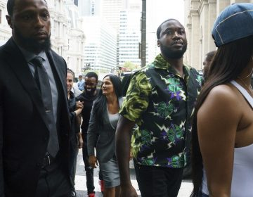 Rapper Meek Mill, (center), arrives at the Criminal Justice Center in Philadelphia on Tuesday, Aug. 27, 2019.  (Jessica Griffin/The Philadelphia Inquirer via AP)
