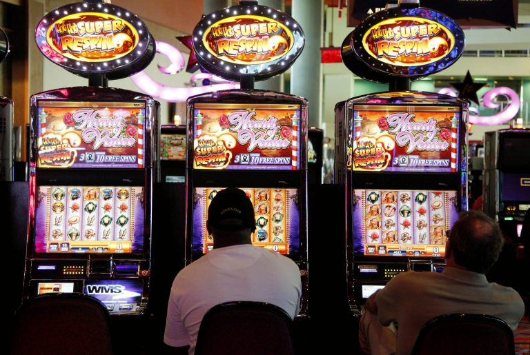 n this May 24, 2012 file photo, patrons play the slot machines at Harrah's Casino in Chester, Pa. (Alex Brandon/AP Photo)
