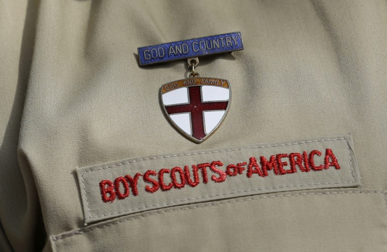 This Feb. 4, 2013 file photo shows a meal pin on a Boy Scout's uniform in Irving, Texas. (Tony Gutierrez/AP Photo)