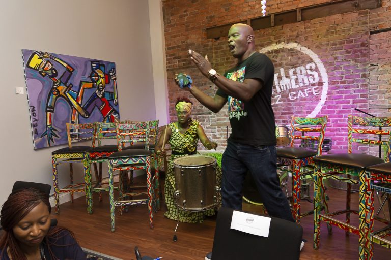 Chester Made Artistic Director Devon Walls leads the crowd in a robust song as Chester Made workshop leader Sistah Mafalda accompanies with African drumming during the Chester Made and Mandela Washington Fellowship Exchange 2019. (Greg Irvin)