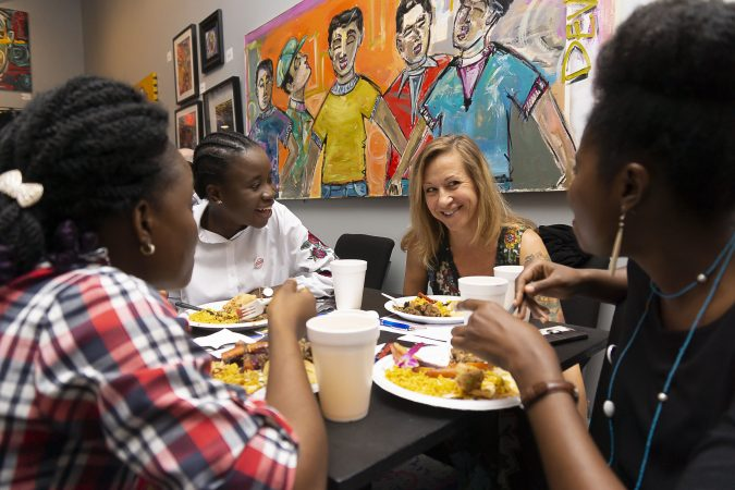 Pauline Guerine (center right), Associate Professor of Psychology at Penn State Brandywine, connects with three Mandela Washington Fellows during a working lunch at Brothers Restaurant and Juice Bar during the Chester Made and Mandela Washington Fellowship Exchange 2019. (Greg Irvin)