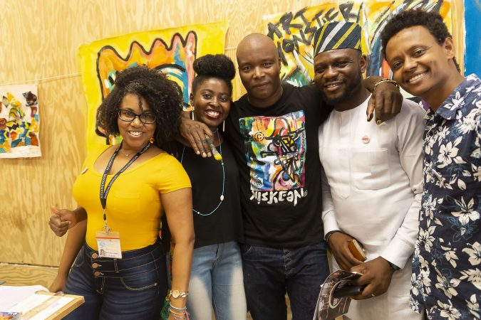Chester Made Artistic Director Devon Walls (center) poses with Mandela Washington Fellows (from left to right), Janice Soraia Fortes Da Graca, Falecia Eliabu Massacky, Sunday Gift Unekwuojo Agbonika, and Desta Mekonen Abreha, in the Chester Made Makerspace during the Chester Made and Mandela Washington Fellowship Exchange 2019. (Greg Irvin)