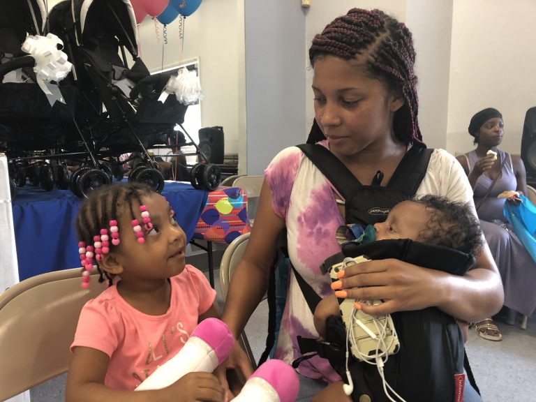 Saadya Elliott Dixon attended the Harper's Heart event at Kingswood with her daughters, Sariyah, who is 3 years old, and Samiyah. (Cris Barrish/WHYY)