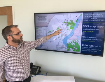 WILMAPCO's Bill Swiatek points to a map from the group's Transportation Justice Plan that shows the high cost of transportation and housing for those living in high poverty areas. (Mark Eichmann/WHYY)