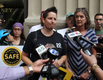 Jill Fredricks Brown urges prosecutors to continue to pursue charges against the driver who killed her niece, Emily Fredricks, as she rode her bicycle in the bike lane on Spruce Street. (Emma Lee/WHYY)