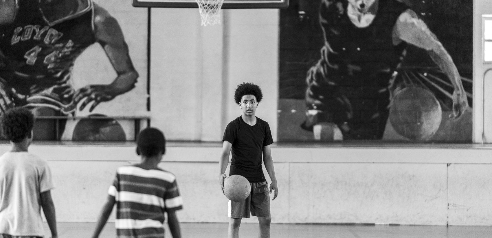 Shawn, 15, inside the Hank Gathers Rec Center gym. (Jessica Kourkounis for Keystone Crossroads)