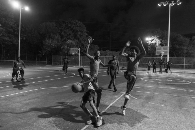 Friday night on the outdoor courts at the Hank Gathers Rec Center in July 2018. (Jessica Kourkounis for Keystone Crossroads)