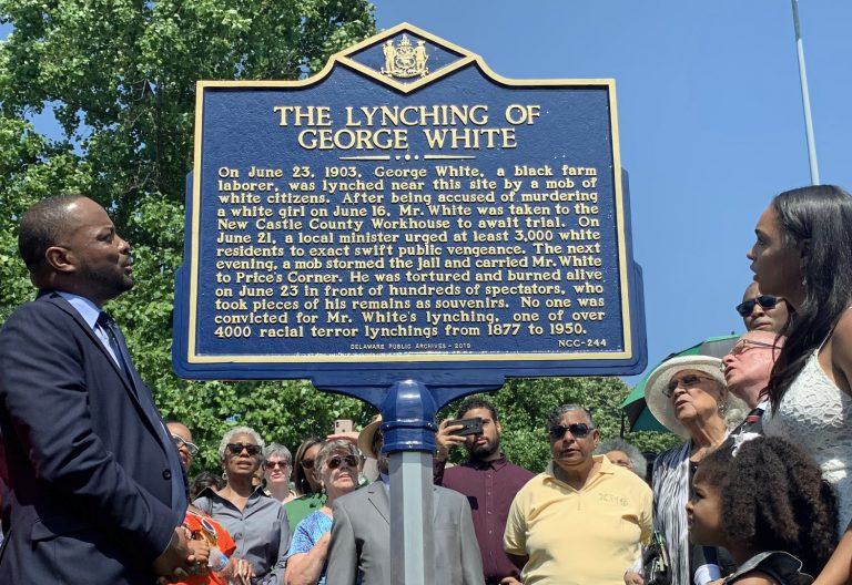 Sen. Darius Brown, Savannah Shepherd and others read the words on The Lynching of George White Historical Marker just minutes after it was unveiled at Greenbank Park on June 23. (Scott Goss/Delaware Senate Majority Caucus)