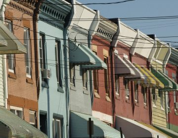 Rowhouses line North 29th Street in Philadelphia