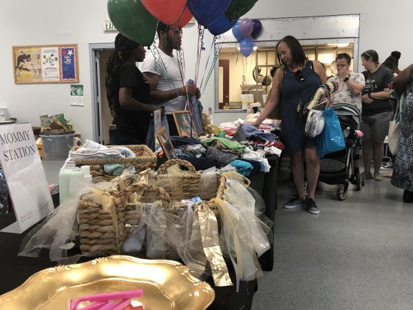 The Harper's Heart giveaway in August at the Kingswood Community Center in Northeast Wilmington drew dozens of expectant mothers and women with newborns, along with their families. (Cris Barrish/WHYY)